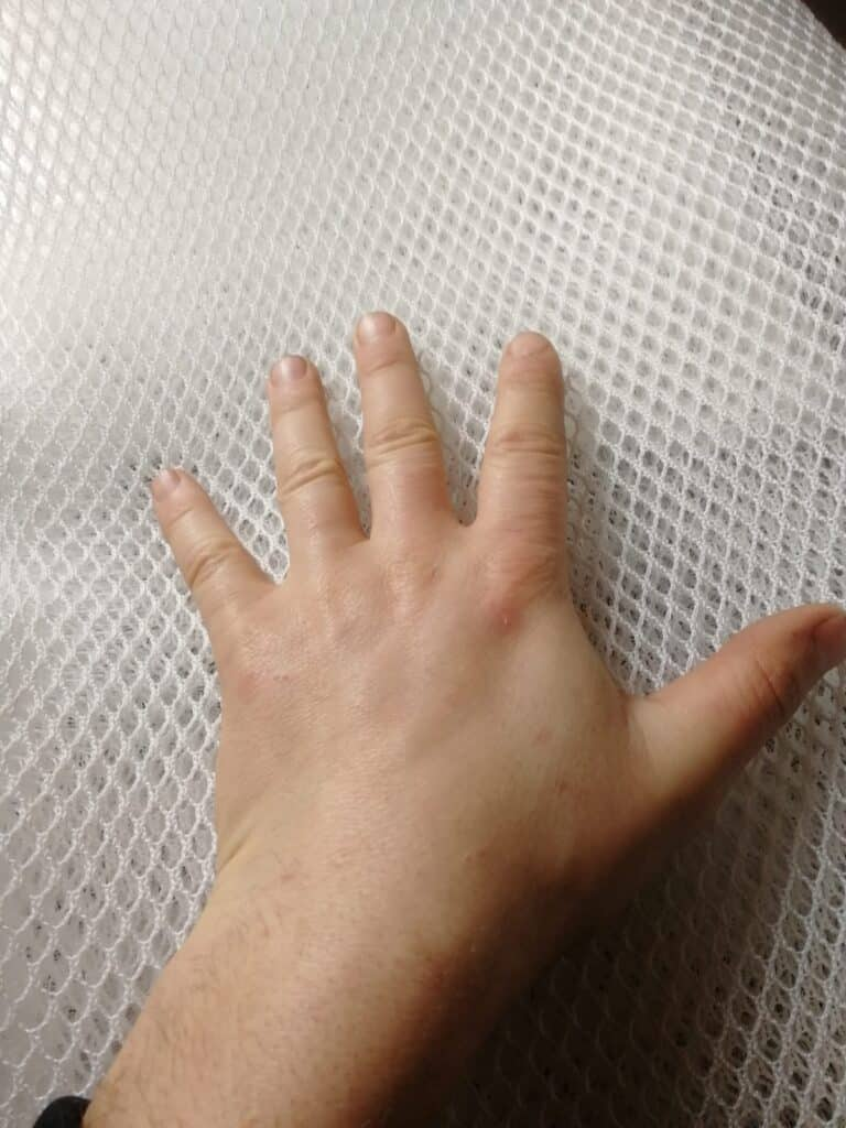Hand On Dry Bed
